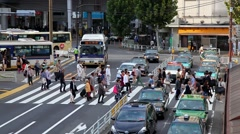 People crossing the street during rush hour in Tokyo, Japan - stock footage