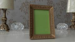One Gold Picture Frame with Green Screen on side table Stock Footage