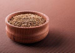 Cumin in a wooden bowl Stock Photos
