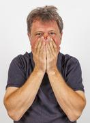 portrait of gesturing handsome man in sorrow - stock photo