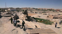 TOURISTS VIEW THE UNFINISHED OBELISK, ASWAN, EGYPT Stock Footage