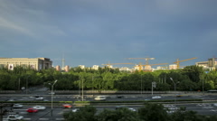 Time lapse of day scene of streams of traffic with changeful clouds in Beijing. Stock Footage
