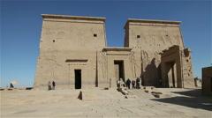 PYLON OF THE TEMPLE OF ISIS, PHILAE, AGILIKA ISLAND, ASWAN, EGYPT Stock Footage