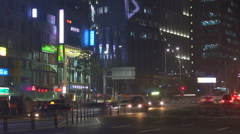 Timelapse traffic road night Seoul people commute commuter tall tower emblem  Stock Footage