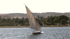 FELUCCA IN FULL SAIL, ASWAN, EGYPT Stock Footage