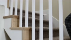 Male walking up the stairs in his home Stock Footage