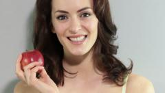 Young woman holding an apple - stock footage
