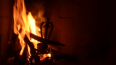 wood trunks in the fire in the fireplace with flame lit - stock footage