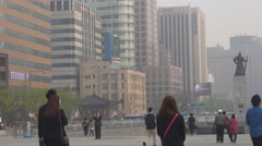 Traffic street Admiral Yi statue Seoul downtown foggy day modern building iconic Stock Footage
