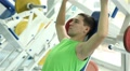 handsome guy doing strength exercises in the gym 12 HD Footage
