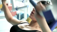 Stock Video Footage of beautiful athletic girl during training in the gym 8