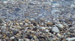 HD sea shore. Blue water. Small rocks, wave. Beach vacation. Summer holiday. Stock Footage