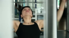 Beautiful athletic girl during training in the gym 3 Stock Footage