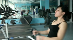 beautiful young girl doing strength exercises in the gym 8 - stock footage