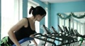beautiful young girl doing strength exercises in the gym 5 Footage