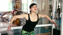 Beautiful young girl doing strength exercises in the gym 4 Stock Footage