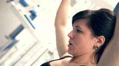 Beautiful young girl doing strength exercises in the gym 2 Stock Footage