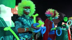 Children's holiday, people in masks make toys from balloons, funny clowns, shows Stock Footage
