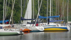Sailing marina, moored yachts and sailboats, luxurious lifestyle Stock Footage