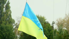 Worn-out Ukrainian flag waving in the wind, symbol of freedom Stock Footage