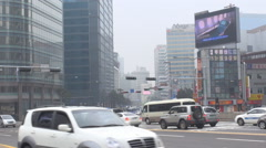 Traffic street car pass Seoul town architecture financial district day smog icon Stock Footage