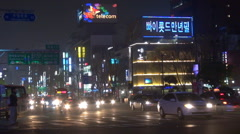 Timelapse congestion avenue car pass jam Seoul center city night asian life icon Stock Footage
