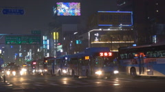 Heavy traffic street night Seoul downtown congestion commuter bustling bus jam   Stock Footage