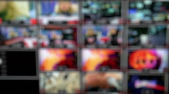 Many monitors in the control room studio TV channel. Out of focus. - stock footage