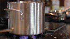 Handheld Pot Over Gas Flame Stock Footage