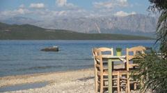 Romantic dinner, beach, table, chairs, restaurant, tavern, calm sea, vacation. Stock Footage