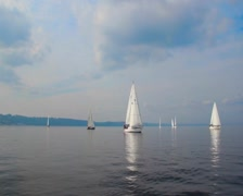 Group of luxury sailing yachts floating open sea before storm - stock footage