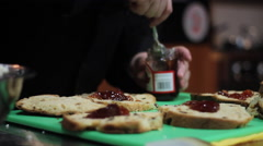 Putting Jam and Icing on Bread Stock Footage