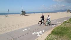 CYCLE PATH VENICE BOARDWALK, VENICE BEACH, VENICE, CALIFORNIA, USA Stock Footage
