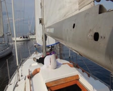 Yachtsman sleeping on deck of sailing yacht. Vacation, holiday - stock footage