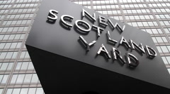 NEW SCOTLAND YARD SIGN, HEADQUARTERS OF THE METROPOLITAN POLICE, LONDON Stock Footage