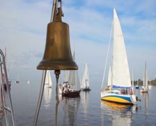 Decorative bronze bell on sailing yacht, traditional symbol Stock Footage