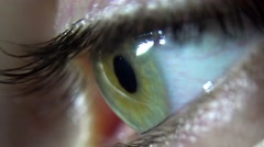 Close-up of green female eye blink and iris focusing - stock footage
