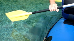 Rafters paddle through water - stock footage