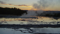 Stock Video Footage of View of Firehole Geyser at sunset, Yellow Stone National Park