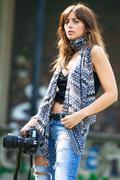 Beautiful woman photojournalist Kuvituskuvat
