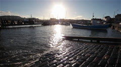 SUN SETS & HIGH TIDE, SCARBOROUGH HARBOUR, NORTH YORKSHIRE, ENGLAND Stock Footage