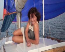 Woman smiling unnaturally at camera, yachting, cruise, vacation - stock footage