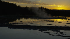 View of Firehole Geyser at sunset, Yellow Stone National Park Stock Footage