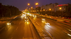 Time lapse of night scene of streams of traffic in Beijing. Stock Footage