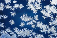 Stock Photo of hoarfrost patterns on glass in the winter