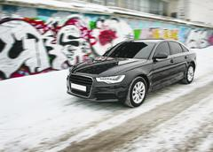 Car in the winter against graffiti Stock Photos