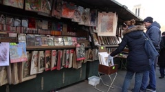 Famous bookseller's boxes along the Seine River in Paris, France. Stock Footage