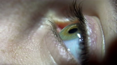 4K Macro close-up of human eye blinking, UHD stock video Arkistovideo