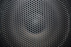 loudspeaker grid with round openings - stock photo