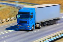 truck moves on highway - stock photo